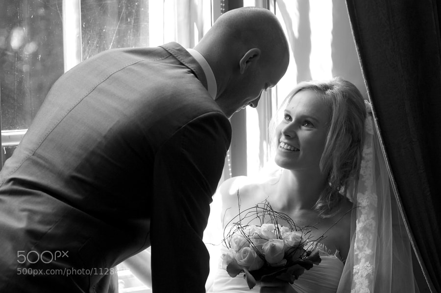 Bride and groom in a window