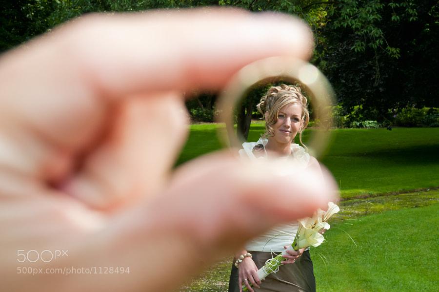 Bride seen through wedding ring