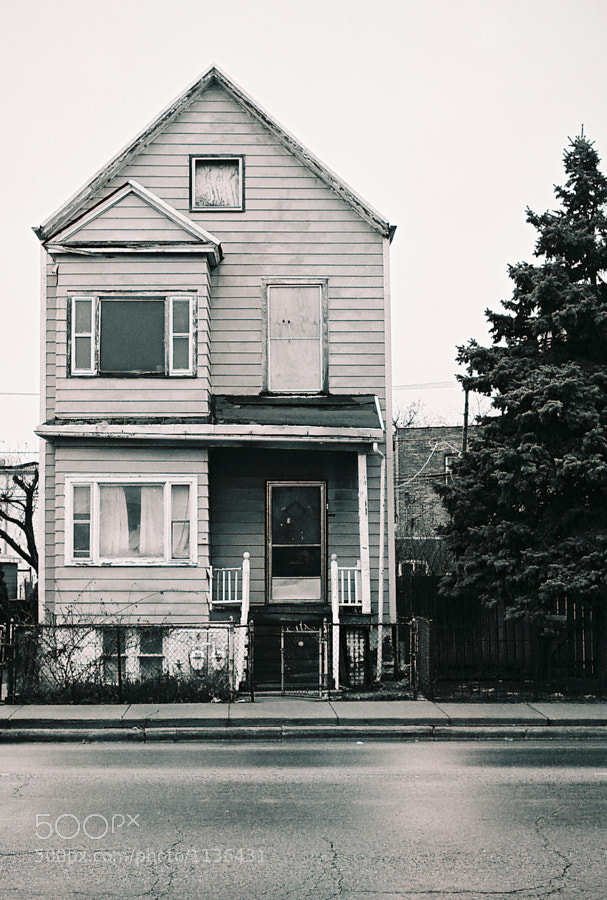 An abandoned house on Chicago's west side. I pass it on my way to work and shot it on black and white film with a Nikon F3 using my 50mm 1.8 lens.