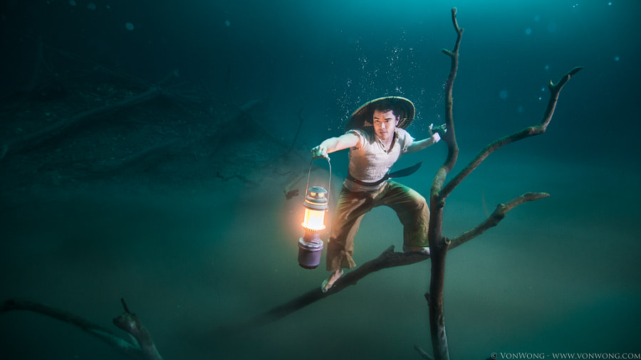 Photograph VonWong's Underwater Fisherman by Benjamin Von Wong on 500px