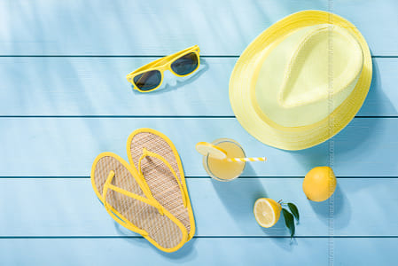 Summer accessories on blue wooden background top view by Kimberly Potvin on 500px