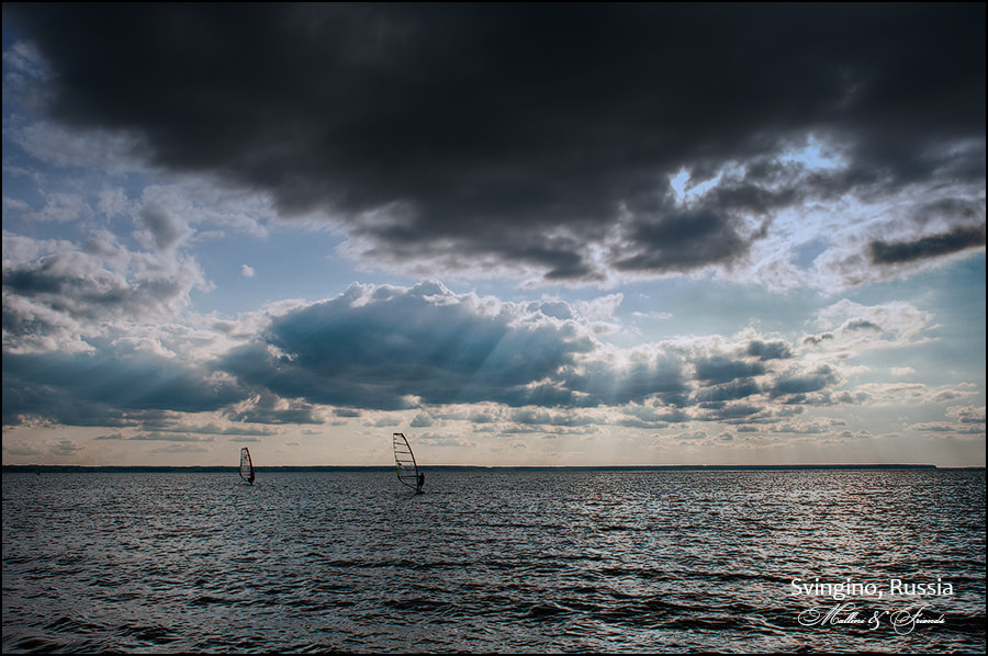 Photograph Windsurfing in rays by Igor M on 500px