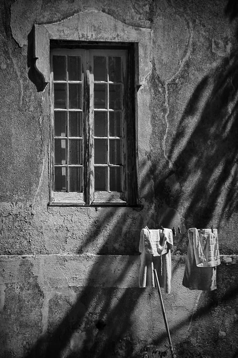 Photograph Facing window drying clothes. by joaocarlo   on 500px