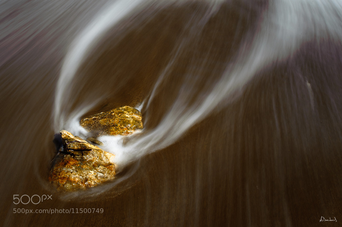 Photograph Stones in flow by Alexander Derenbach on 500px