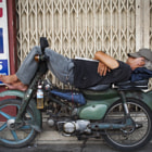 A motorbike-driver on his midday-nap.