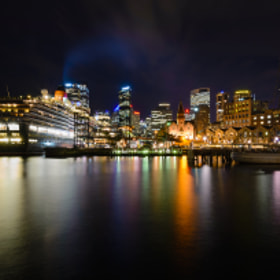 Nighttime view of the Queen Victoria docked in Circular Quay, Sydney, Australia