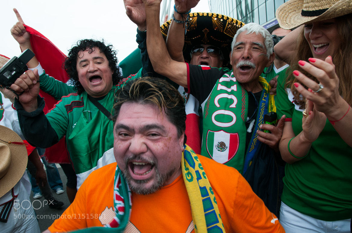 Photograph Mexican Fans Celebrating #3 by Frozen Canuck on 500px