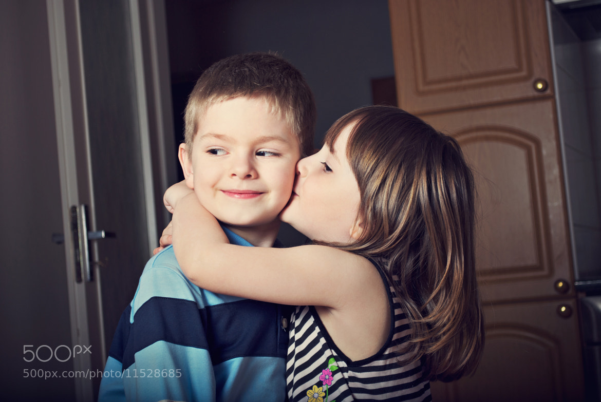 Photograph Adorable little girl kissing a boy by Olinka Ukhal on 500px
