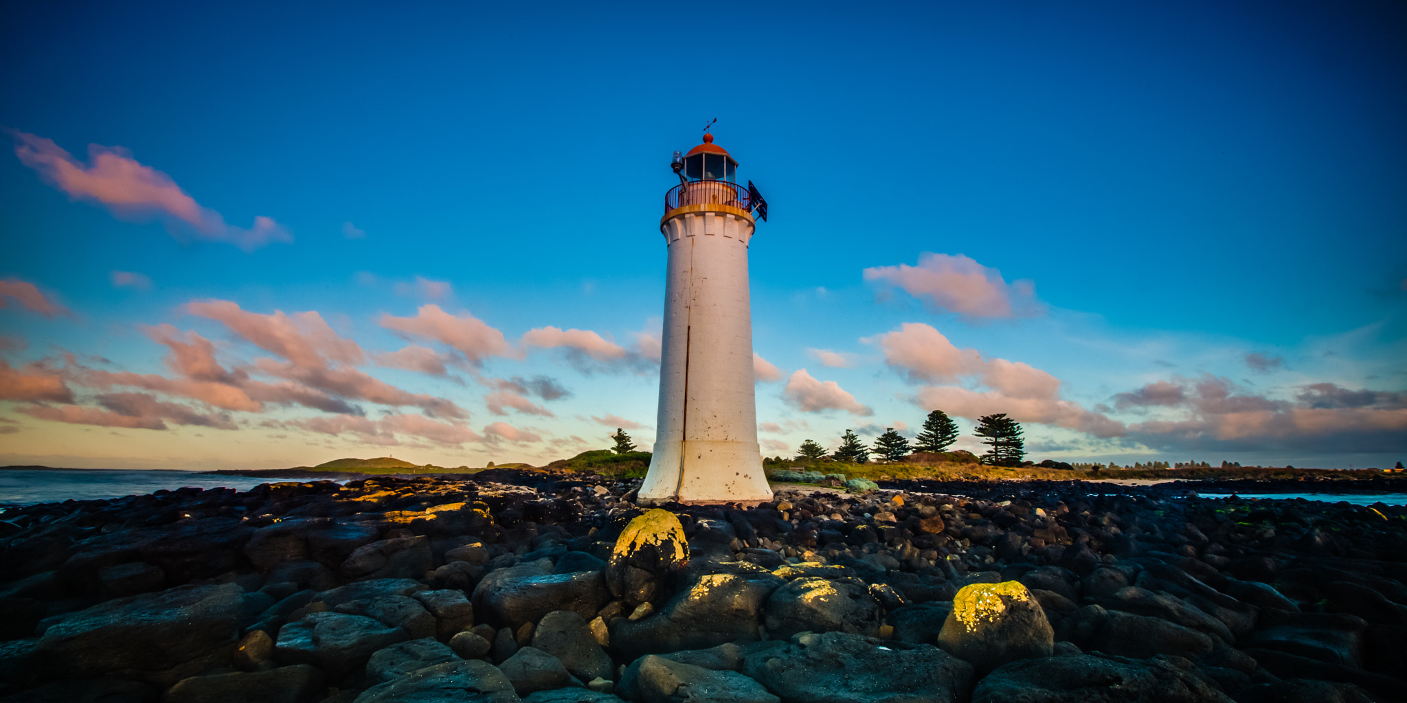 Photograph Port Fairy lighthouse moving low clouds sunrise by Oat Vaiyaboon on 500px