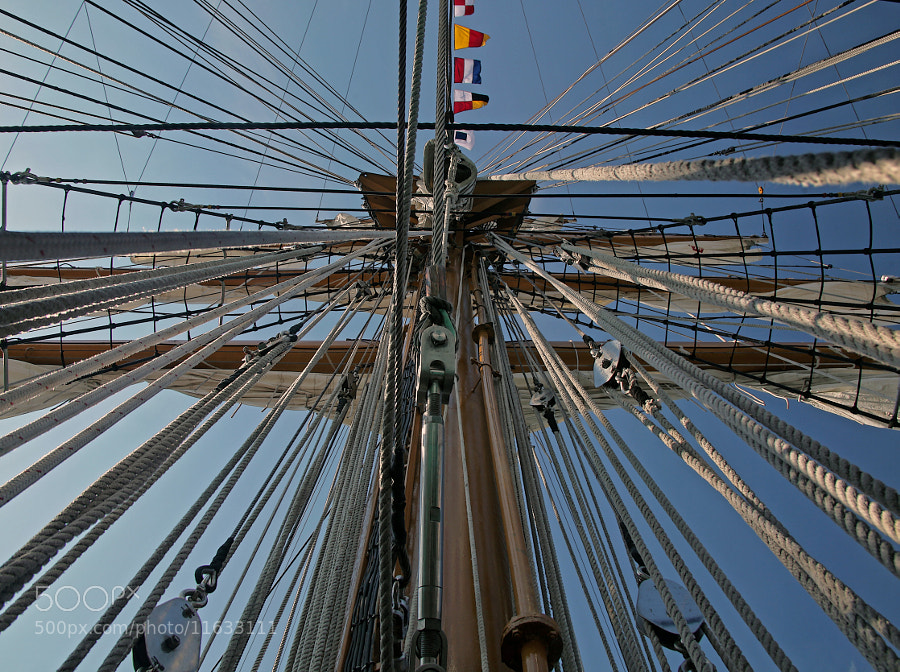 "This shot was taken during the Tall Ships visit to Inner Harbor, Baltimore, MD.  I just happened to look up through a hatch in the deck and said, ""WOW!""  that's a lot of rope."