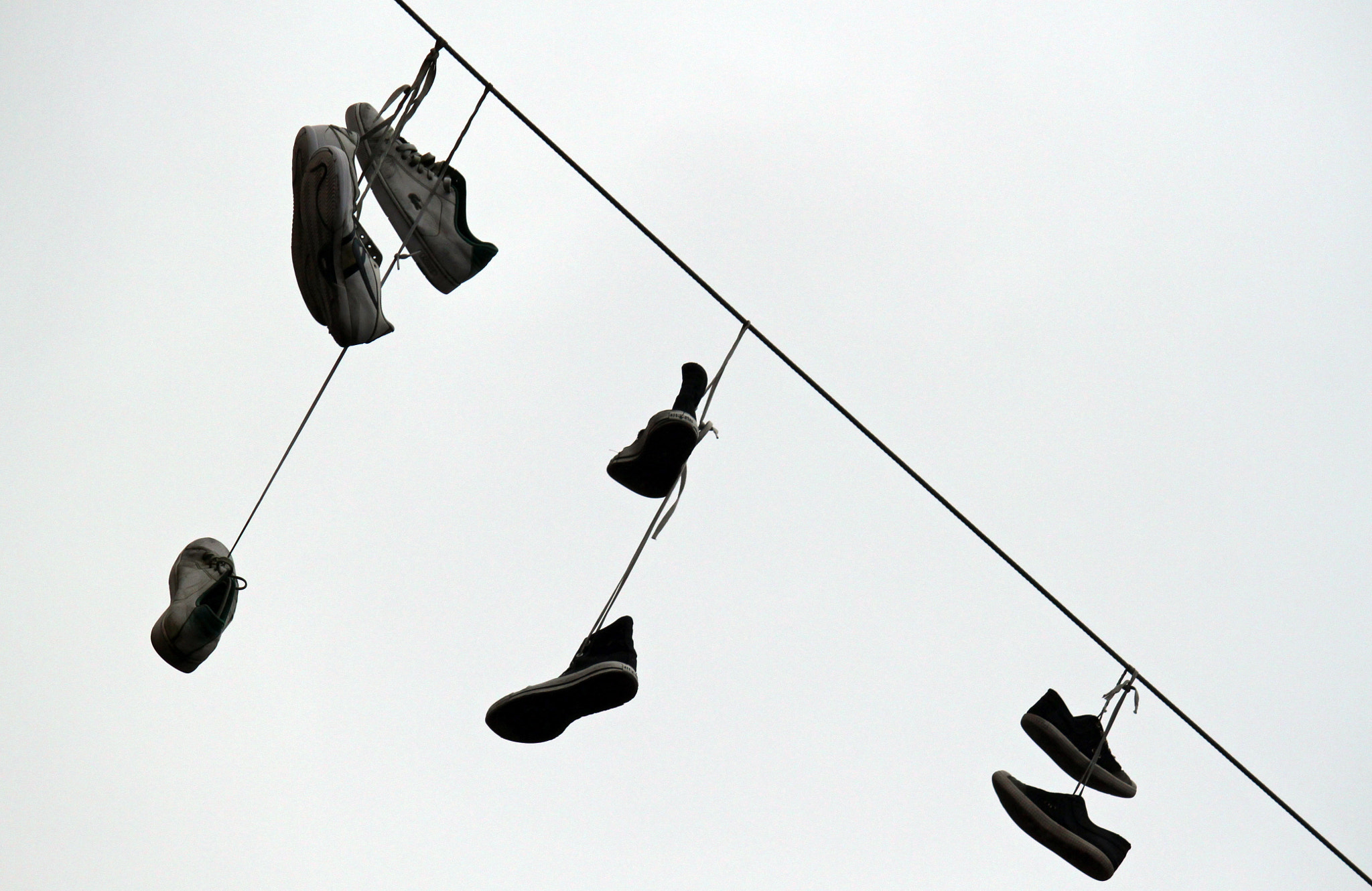 Photograph Hanging shoes by Anne-So Hottiaux on 500px