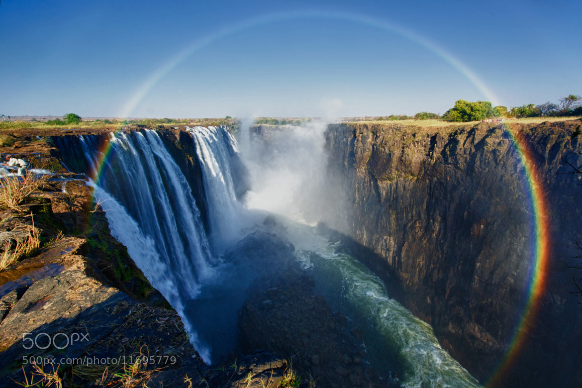 Photograph Full rainbow over the Victoria falls by Nicole Cambré on 500px