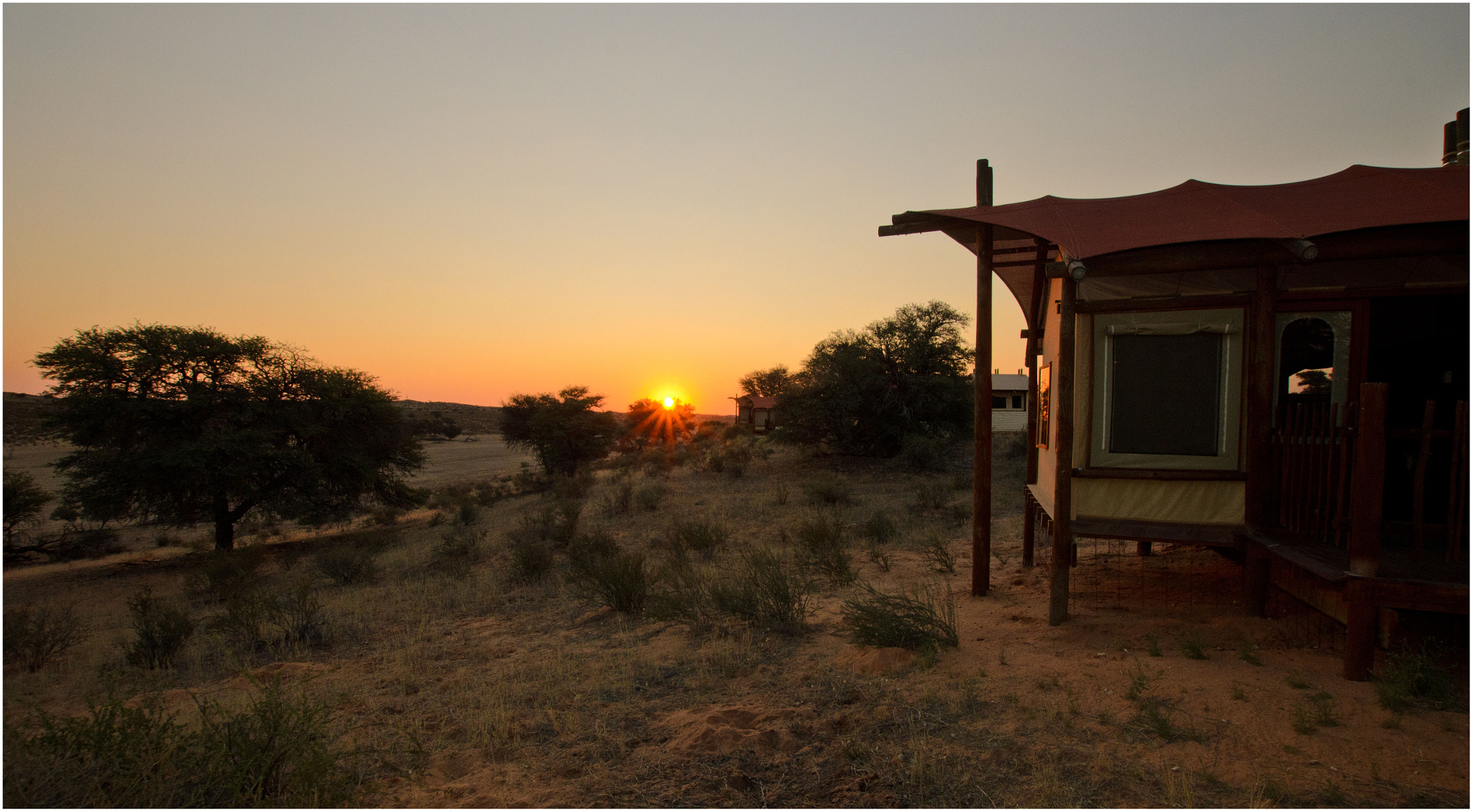 Photograph Kalahari Tented Camp Sunset by Christopher van Zyl on 500px