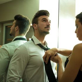 A young couple getting dressed in the changing room