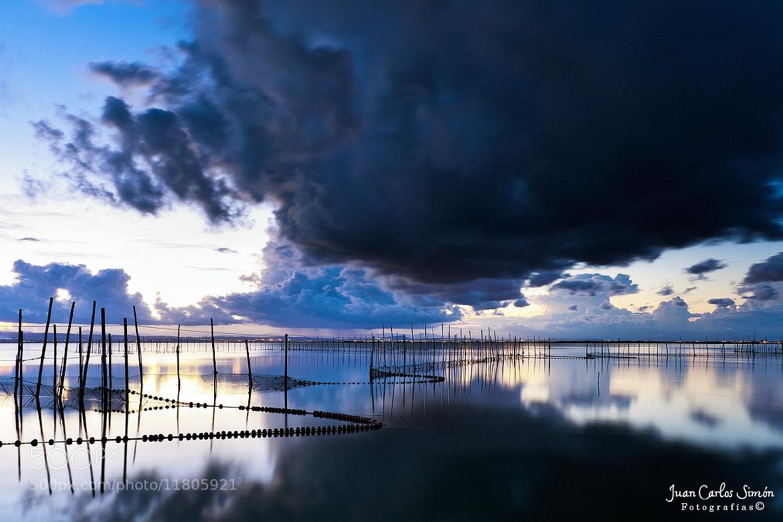 Photograph Entre nubarrones (between clouds) by Juan Carlos Simón on 500px
