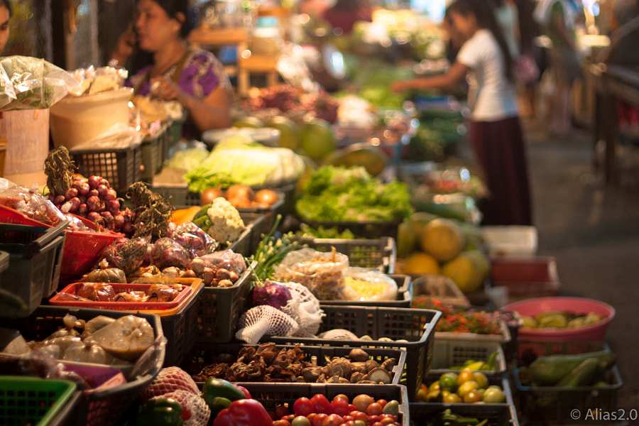 Food stall at Thai market by Julien Vernet