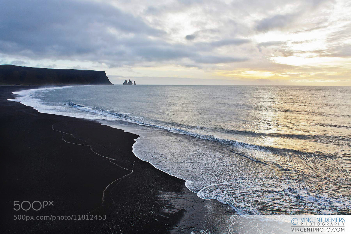 Photograph View on Dyrhólaey from the black beach in Vík, Iceland by Vincent Demers on 500px