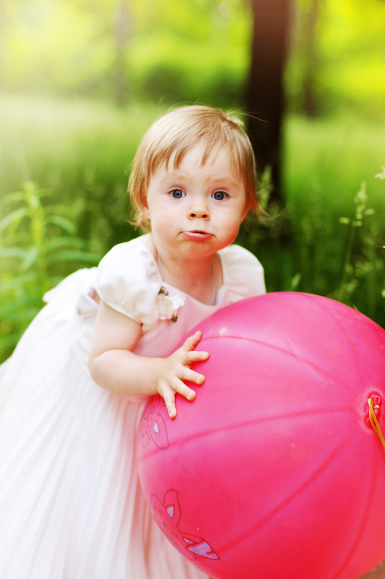 Photograph The little girl with a ball by Irina Oreshina on 500px