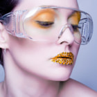Young caucasian woman with gold fashion makeup by Oat Vaiyaboon