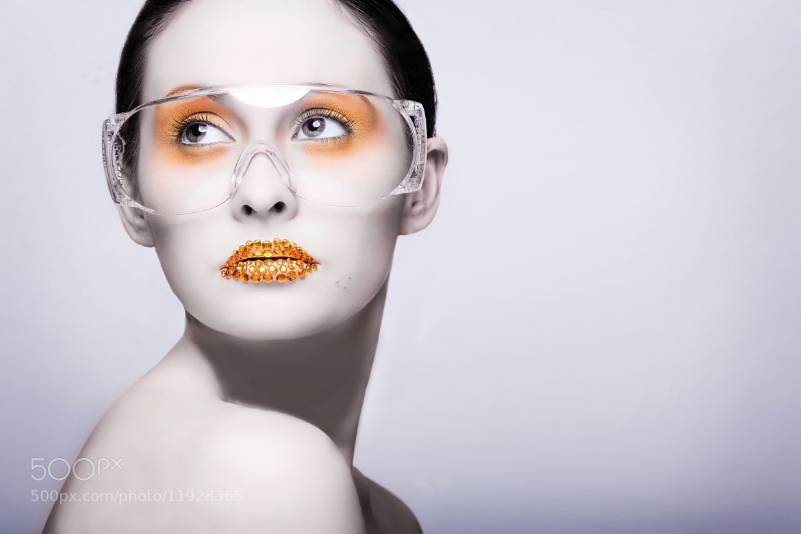 Photograph Young woman with gold fashion makeup by Oat Vaiyaboon on 500px
