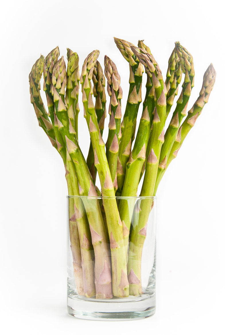 Photograph Bunch of fresh green asparagus standing in a glass by Izabela Korwel Korwel Photography on 500px