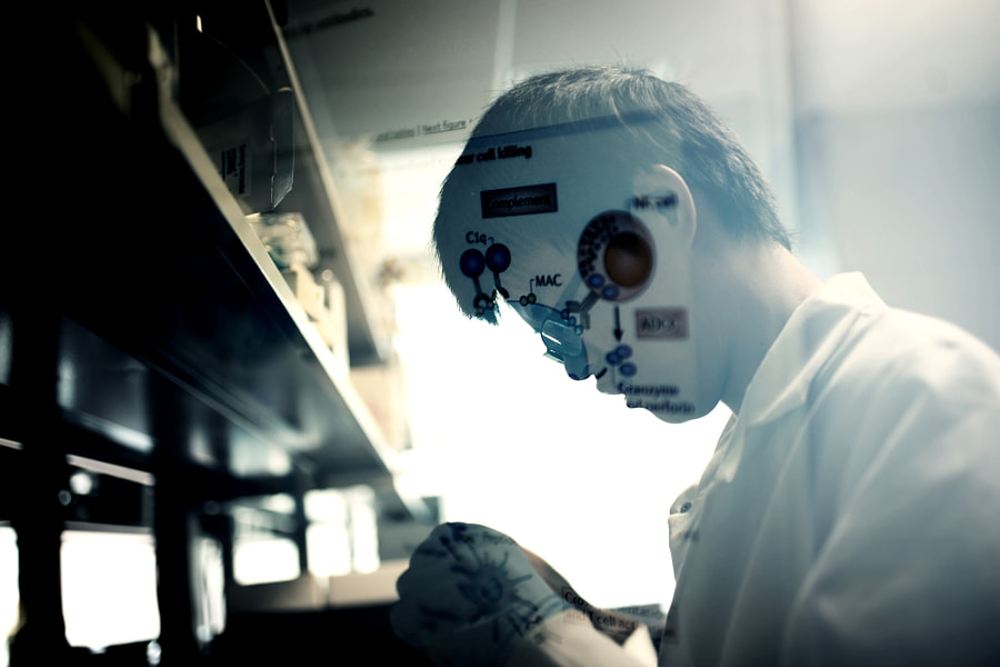 A student/researcher works on the lab of Dr. Zhen