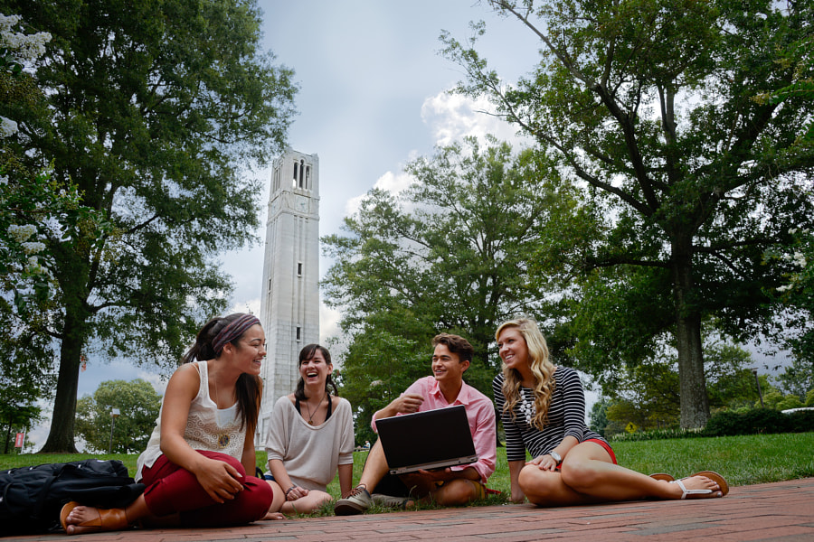 Students talk at the Belltower on campus.