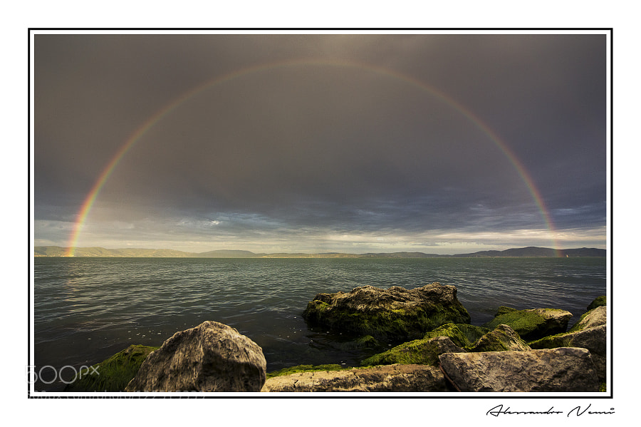 Rainbow over the lake by AlessandroNenci