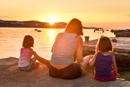 Mother and daughters are enjoying a sunset at the sea by Janet Weldon on 500px