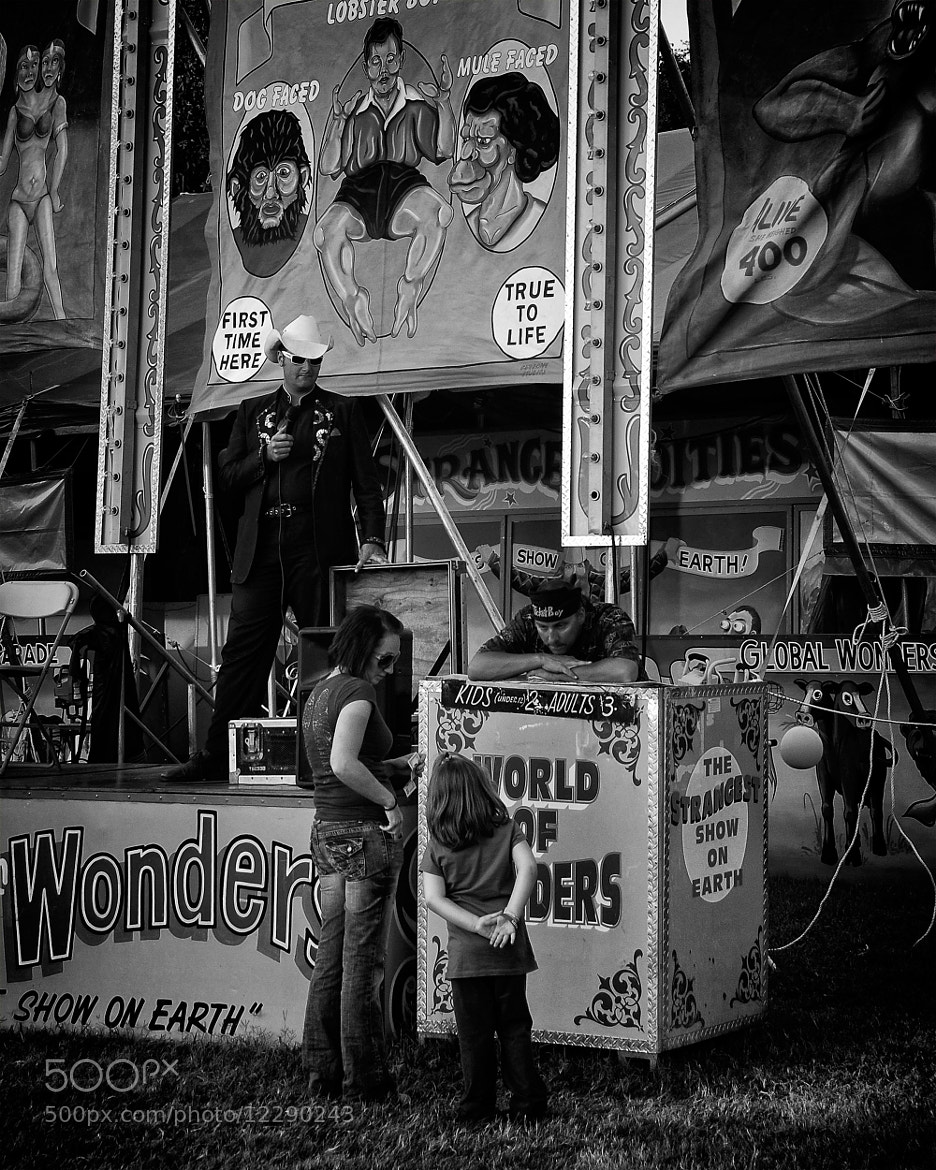 Photograph Examining a Side Show at the Fair by Tom Bell on 500px