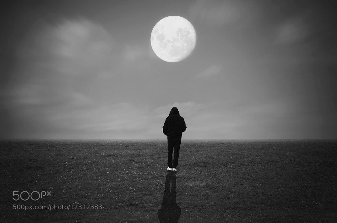 Photograph in front of the moon by Adrian Limani on 500px