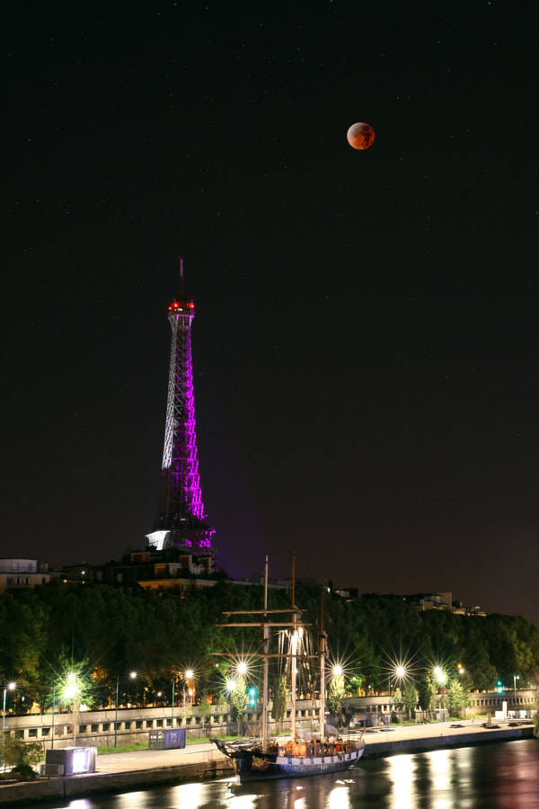 Eiffel Tower, SuperMoon & Lunar eclipse 1 by Nicolas Forszpaniak on 500px.com