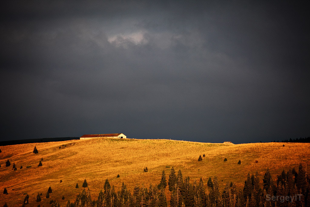 Photograph Farm house on remote hill and dark clouds above by Sergiy Trofimov on 500px