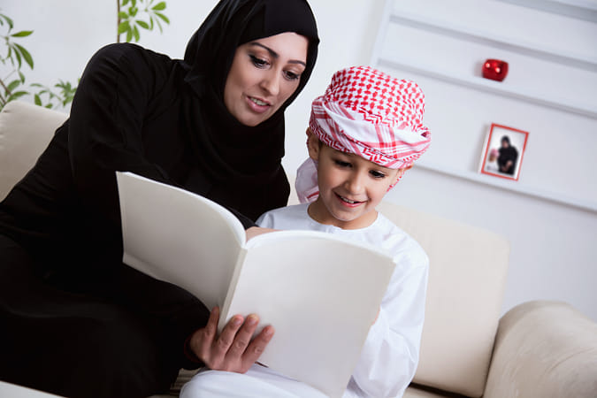 Arabic Mother And Son Reading A Book by Janet Weldon on 500px
