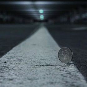 Photograph Coin by Lukas Bachschwell