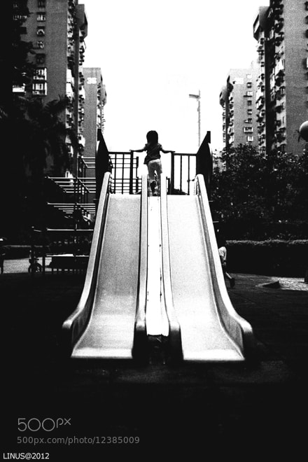 Photograph play on the slide by Linus Lai on 500px