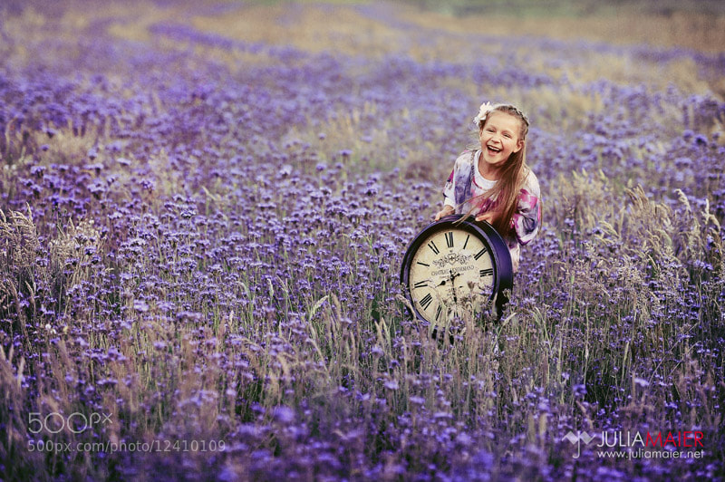 smiling girl and flower field