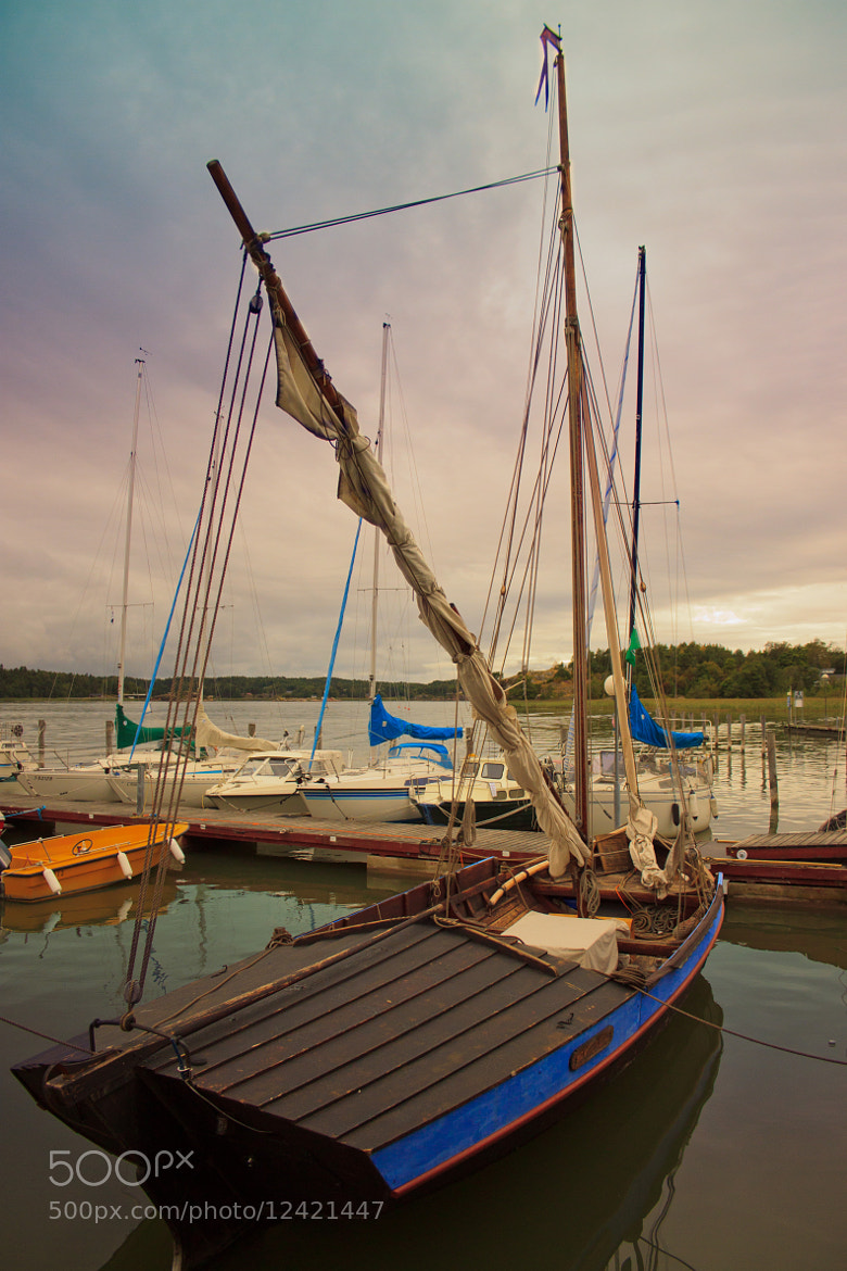 Photograph Boat in colorful harbor by Fiona Stops on 500px