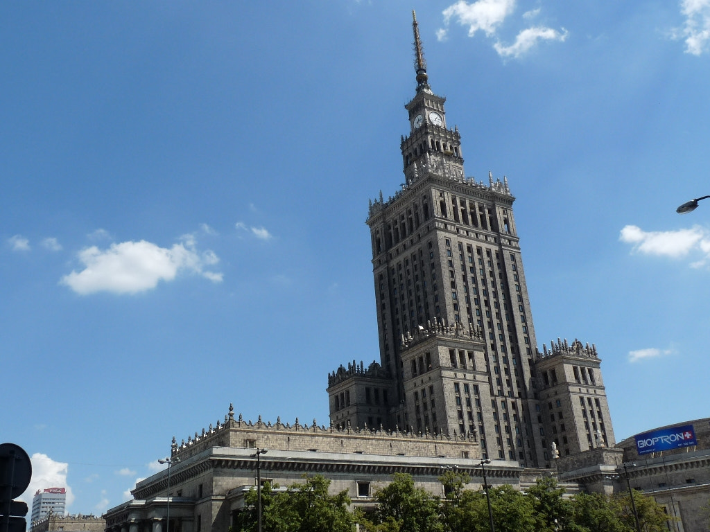 Photograph Warsaw Culture and Science Palace under a blue sky by Romain Galati on 500px