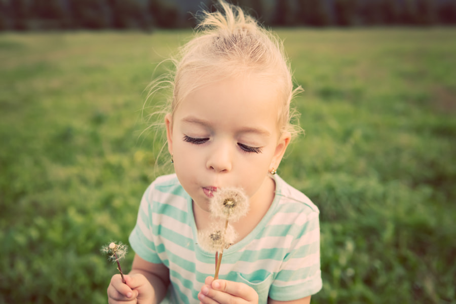 Adorable little blond girl with dandelion flower. Happy kid having fun outdoors by Andrea Obzerova on 500px.com
