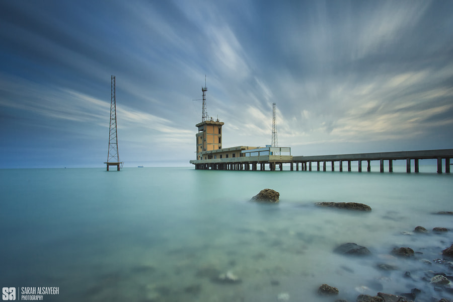 Fine Art Landscape Photography The Moving Clouds Sunrise Over Abandoned Place by landscape and nature photographer Sarah Alsayegh