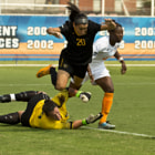 VCU Senior Wendy Acosta fights Tennessee Sophomore Iyana Moore and narrowly avoids fellow senior goalkeeper Kristin Carden.
