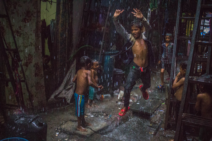 kids playing in the rain by Yash Sheth on 500px.com