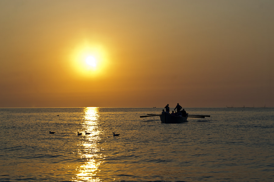 Fishermen on sunrise