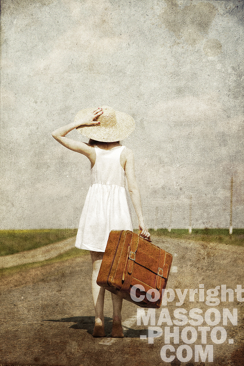 Photograph Lonely girl with suitcase at country road. by Vladimir Nikulin / Masson on 500px