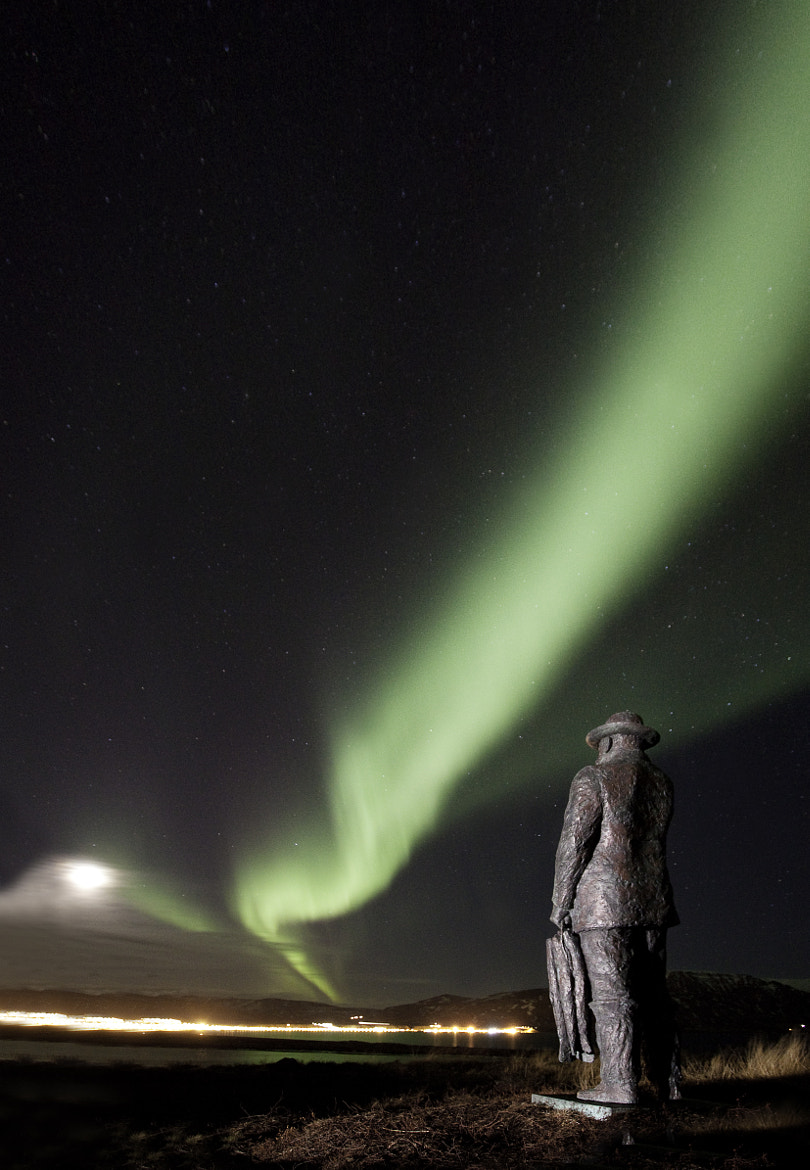 Photograph Northern lights and the Ferryman by Jon Hilmarsson on 500px