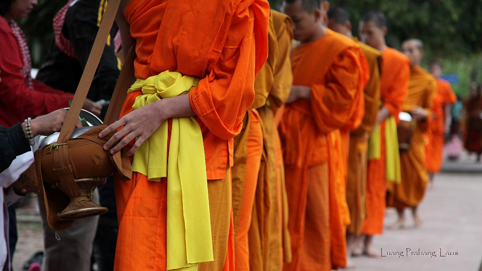 Photograph Giving alms to monks by Edward Lai on 500px