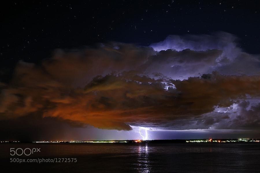In rather unstable atmosphere last night big cumulonimbus developed on Velebit massif, enlightening beautiful summer night on Ugljan island in Zadar archipelago, Croatia