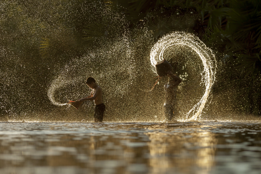 silhouette  Thai boys splashing with friend  in the river by Jakkree Thampitakkul on 500px.com
