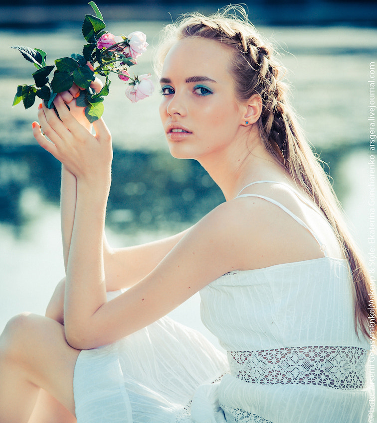 Photograph Portrait of a lovely girl sitting on the river bank by Arsenii Gerasymenko on 500px
